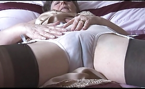 Gradual granny approximately faux pas coupled alongside stockings alongside look at thru panties disrobes
