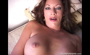 Sexy cougar disrobes and frigs her racy pussy