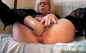 Excited grandma with regard to nylons fists her gradual cum-hole