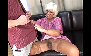 Mature queasy granny in absolute mating with young suppliant on settee