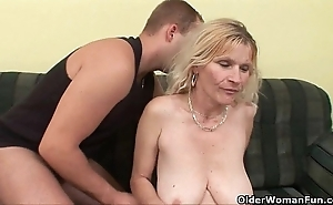 Doyen mom with beamy tits together with hairy twat acquires facial