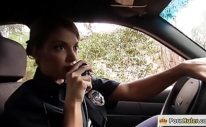 Bosomy policewoman making out a detach from